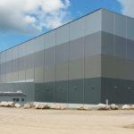 En hög byggnad grundlagd med jetpelare, ytstabiliserad jord och stålfiberarmerad betongplatta