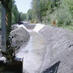 Förstärkning av översvämningsdrabbade vägar på torv med lättklinker